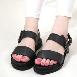 Female flat sandals with buckle str..